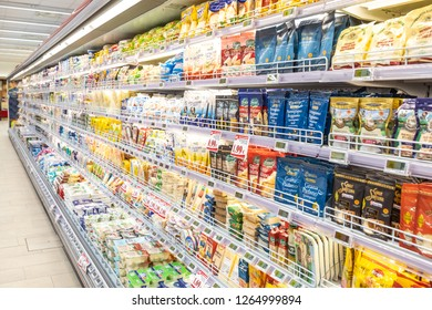 ROME, ITALY. December 05, 2018: Lanes of shelves with goods products inside a MA supermarket in Italy in Rome. Variety of preserves and pasta. Shelves full and tidy.