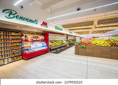 ROME, ITALY. December 05, 2018: Fruit and vegetable department with numerous varieties of fruit exposed inside a MA supermarket in Italy in Rome. Crates of fruit and vegetables in a large space.