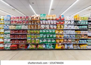 ROME, ITALY. December 05, 2018: Food department for dogs and cats. Shelving with various types of food for pets inside a MA supermarket in Rome in Italy.