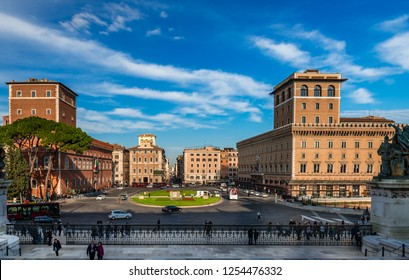 Rome / Italy - December 1 2018: Piazza Venezia, as seen from the Monument to Vittorio Emanuele II with Palazzo Venezia to the left and and the Via del Corso in the background.