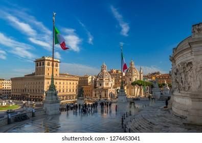 Rome / Italy - December 1 2018: Piazza Venezia, two churches (Chiesa di Santa Maria di Loreto & Chiesa del Santissimo Nome di Maria al Foro Traiano) and Trajan's Column, as seen from Vitoriano.