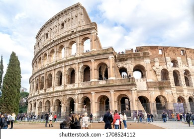 Rome, Italy - December 15, 2019: Colosseum in Rome with people and tourists walking around it.