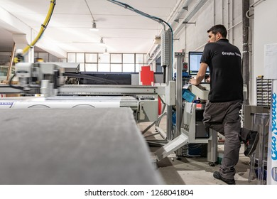 Rome, Italy, December 2018. Computer aided printing process, advanced technology in the publishing sector, latest generation robotized plotting machines for mass production and big format prints.