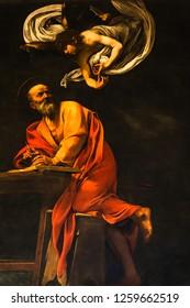 Rome, Italy - December 2018: Inspiration of Saint Matthew, 1602 Baroque painting by Michelangelo Merisi da Caravaggio, in Contarelli chapel, Church of St. Louis of the French (San Luigi dei Francesi)