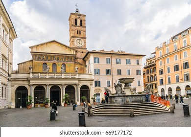 ROME, ITALY - DECEMBER 28, 2016: Piazza di Santa Maria in Trastevere and Basilica Our Lady in Trastevere (Basilica di Santa Maria in Trastevere, 1143), one of the oldest churches of Rome.