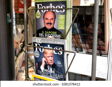 ROME, ITALY - DECEMBER 30, 2017: Retail trade of Forbes magazines with Donald Trump and Oscar Farinetti