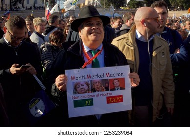 "Rome, Italy - December 8 2018: A man with an Anti EU sign during Matteo Salvini's speech. """"We do not give in to blackmail - ITEXIT"""