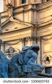 Rome, Italy - December 9, 2018: Piazza Navona, statue of the river-god Rio de la Plata, Fountain of the Four Rivers (Fountain of the Four Rivers) work by Bernini