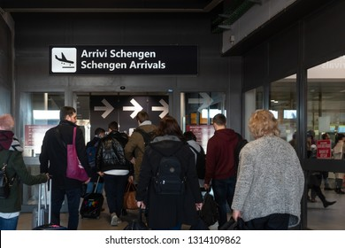 Rome / Italy - Feb 14, 2019: Passengers arriving at Ciampino airport go through the entrance for Schengen arrivals.