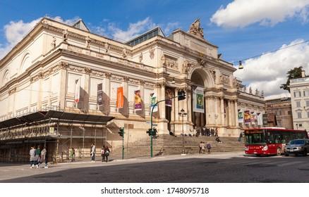 Rome, Italy - February 13, 2016: Ordinary people are near The Palazzo delle Esposizioni, a neoclassical exhibition hall, cultural center and museum on Via Nazionale in Rome