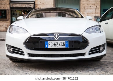 Rome, Italy - February 13, 2016 : White Tesla model S car parked on urban roadside in Rome, front view, close up photo
