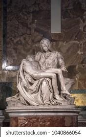 "ROME, ITALY - FEBRUARY 15, 2018: Famous Renaissance sculpture ""La Pieta"" by Michelangelo Buonarroti in St. Peter's Basilica in Vatican"