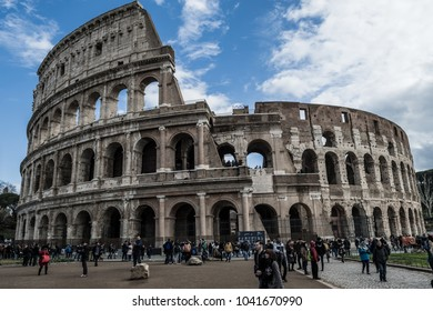 ROME, ITALY - FEBRUARY 15, 2018: Tourists visit the  Colosseum, the famous amphitheatre, in the city of Rome