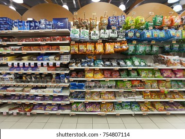 "ROME, ITALY. February 16, 2015: Shelving with sweets, candies and chocolates. Shelves inside ""PANORAMA"" a supermarket store in Rome, Italy."