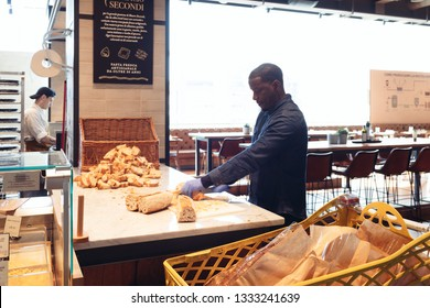 ROME, ITALY - FEBRUARY 17, 2019: People work  in small restaurant inside Eataly hypermarket in Rome, at Ostiense station, creating and offering the best products.
