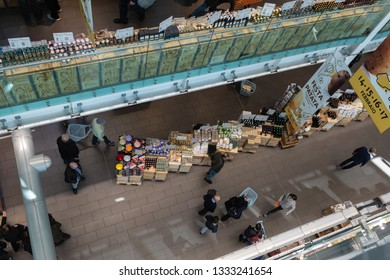 ROME, ITALY - FEBRUARY 17, 2019: Buyers shopping on Sunday at Eataly, an Italian multi-level gastronomic mega-store opened in 2012 in the old terminal of the Ostiense Station in Rome.