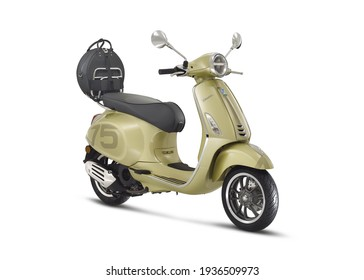 Rome, Italy - February 18, 2021: A green Vespa 75th GTS and Primavera motorcycle is parked in showroom with white background