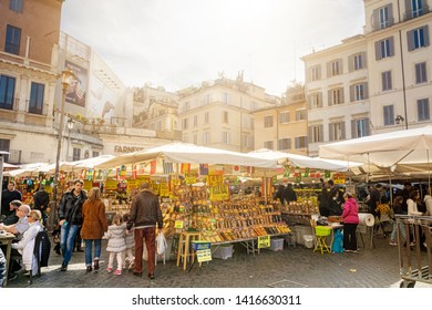 "Rome, Italy, February 2017: Daytime view of the ancient vegetable market in Piazza Campo de Fiori in Rome. Campo de' Fiori, translated literally from Italian, means ""field of flowers"""