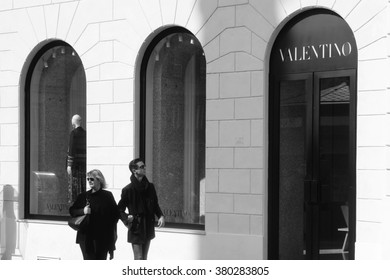 ROME, ITALY - FEBRUARY 21 2016: Pedestrians pass a Valentino store at Piazza Mignanelli, Rome