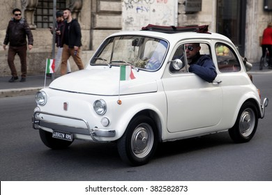 ROME, ITALY - FEBRUARY 21 2016: A Fiat 500 with italian flags on the streets of Rome, Italy. It soon become an italian symbol