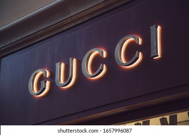 ROME, ITALY - FEBRUARY 21, 2020: Gucci logo on Gucci's shop. Gucci is an international Italian clothing company founded by Guccio Gucci in Florence, Tuscany, in 1921.