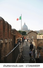 Rome, Italy - February 24, 2012: On the top of the roof Sant'Angelo Castel's. view of the dome Saint Peter's Basilica and flag of Italy