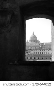 Rome, Italy - February 24, 2012: View to the dome Saint Peter's Basilica from Castel Sant'Angelo, window on the wall