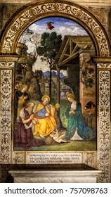 ROME, ITALY. February 24. 2015: The Adoration of the Child. Pinturicchio. Della Rovere Chapel of the Nativity (Italian: Cappella del Presepio). Santa Maria del Popolo church, Rome. Italy.