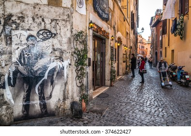 ROME, ITALY - February 6th, 2016 - Old street in Trastevere neighbourhood.  Trastevere maintains its character thanks to its narrow cobbled streets lined by ancient houses