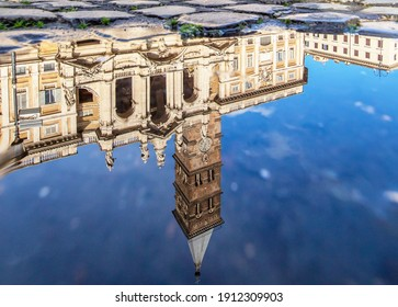 Rome, Italy - February 8th 2021 - in Winter time, frequent rain showers create pools in which the wonderful Old Town of Rome reflects like in a mirror. Here in particular Santa Maria Maggiore
