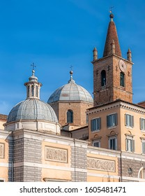ROME, ITALY - JANUARY 08, 2014: The front facade of the Basilica Parrocchiale Santa Maria del Popolo at one of Rome's most popular piazzas.