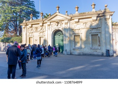 ROME, ITALY - JANUARY 1, 2017: People waiting to get a view of Saint Peter's Basilica through the keyhole of the door leading to the Villa del Priorato di Malta in Cavalieri di Malta square.