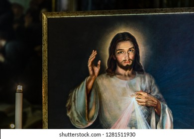 ROME, ITALY - JANUARY 1, 2019: light is enlightening painting of Merciful Jesus