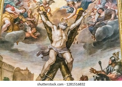 ROME, ITALY - JANUARY 1, 2019: light is enlightening painting of the Martyrdom of Saint Andrew by artist Mattia Preti in the basilica of Santo Andrea Della Valle in Santo Eustachio district