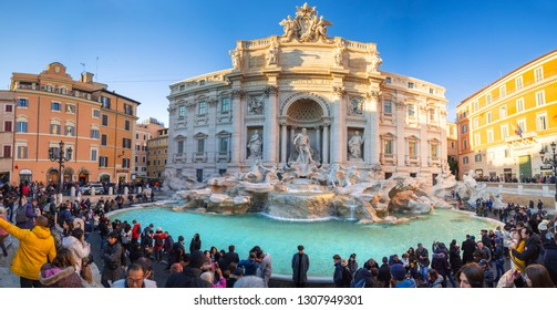 Rome, Italy - January 10, 2019: People at the Trevi Fountain in Rome at sunset, Italy