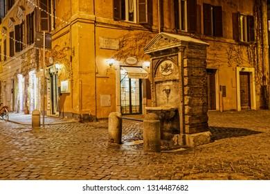 ROME, ITALY - January 16, 2019 No pople around Fountain at Catalone square on Borgo Pio street in Rome near Vatican city at winter night.