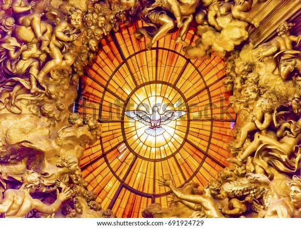 ROME, ITALY - JANUARY 18, 2017 Throne Bernini Holy Spirit Dove Saint Peter's Basilica Vatican Rome Italy.  Bernini created Saint Peter's Throne with Holy Spirit Dove Stained Glass Amber in 1600s