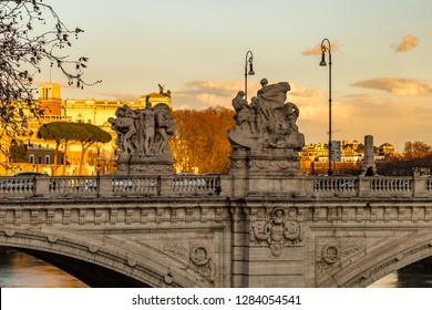 ROME, ITALY - JANUARY 2, 2019: tourists walking on Sant'Angelo bridge in Rome while waters of Tiber river are flowing