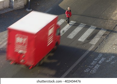 Rome, Italy - January 2016: Pedestrian is about to be hit by a truck in Rome downtown