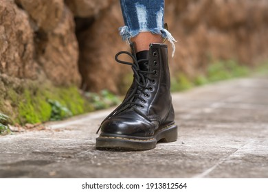 Rome, Italy - January 22, 2021: Classic black leather Dr. Martens AirWair boots. Dr Martens is an English footwear, accessories and clothing brand