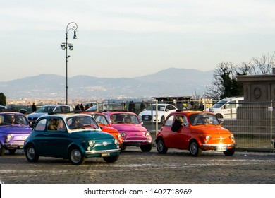 Rome, Italy - January 26 2019: colorful fiat 500 cars driving around in Rome.