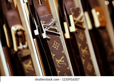 "Rome, Italy - January 27 2012: belts with ""LV"" logo buckles sit on display inside the new Louis Vuitton ""Etoile"" store, operated by LVMH Moet Hennessy Louis Vuitton SA, in a former cinema in Rome."