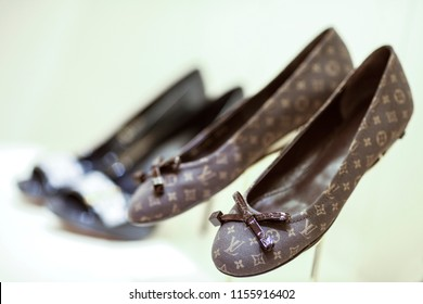 "Rome, Italy - January 27 2012: Louis Vuitton-branded shoes sit on display inside the company's new ""Etoile"" store, operated by LVMH Moet Hennessy Louis Vuitton SA, in a former cinema in Rome."