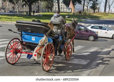 ROME, ITALY - JANUARY 29, 2017: Tourist Horse-drawn carriage waiting to cross the street in della Greca street.