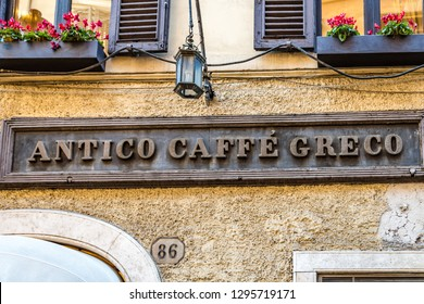 ROME, ITALY - JANUARY 3, 2019: lights are enlightening   ANTICO CAFFE GRECO logo on storefront