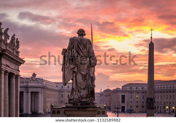 ROME, ITALY - JANUARY 31, 2017: Sunrise over the St. Peters Basilica in Vatican City. Morning at the most famous landmark, empty of people street, cloudy sky.