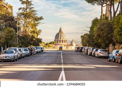 ROME, ITALY - JANUARY 5, 2019: light is enlightening the Dome of Saint Peter Basilica. Weird optical illusion in Piccolomini street, as you get closer to the Dome, the smaller it appears
