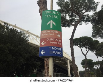 Rome, Italy - January 7, 2018: Arrow signs to Tevere Tribune, North Curve, South Curve and Monte Mario Tribune entrances to the Olympic Stadium. The Stadio Olimpico is the main sports facility of Rome