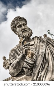 Rome, Italy - July 12, 2014: Detail of the statue of St. Peter with the key in front of the cathedral of San Pietro. The Basilica of St. Peter is the main church papal primary symbol of Catholicism.