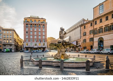 Rome, Italy - July 13th 2015: The Triton Fountain by Gian Lorenzo Bernini at Piazza Barberini outside the Bernini Hotel early in the morning after sunrise in the historic ancient city of Rome